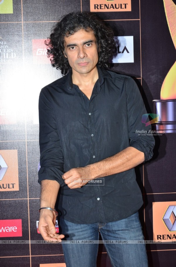 Imtiaz Ali poses for the media at Star Guild Awards