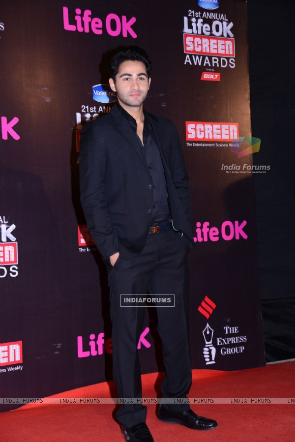 Armaan Jain poses for the media at 21st Annual Life OK Screen Awards Red Carpet