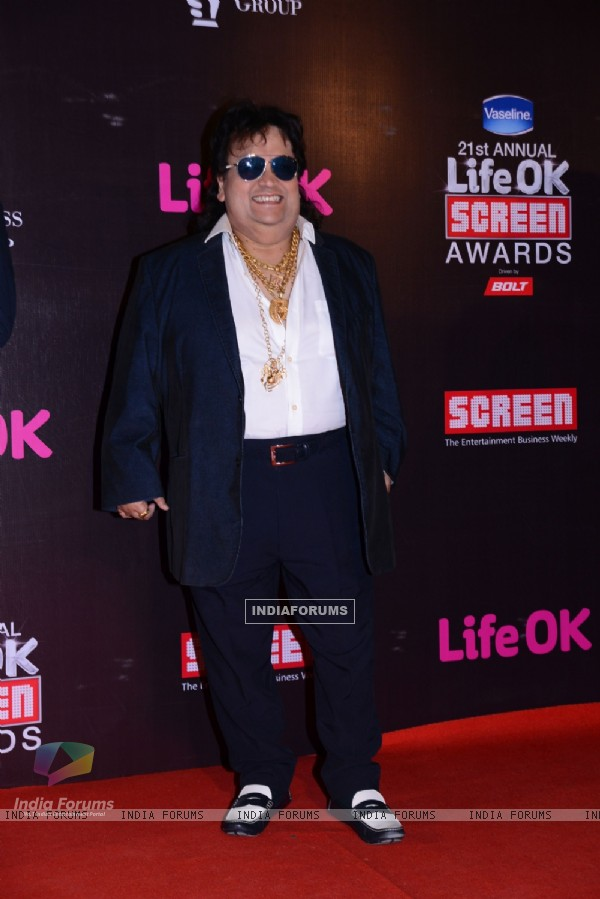 Bappi Lahiri poses for the media at 21st Annual Life OK Screen Awards Red Carpet