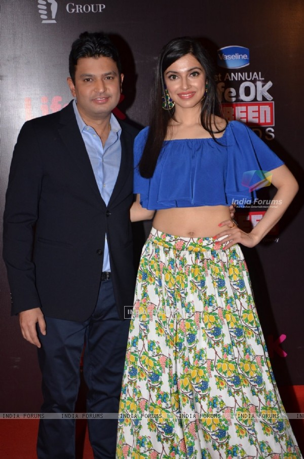 Bhushan Kumar poses with wife Divya Khosla at 21st Annual Life OK Screen Awards Red Carpet