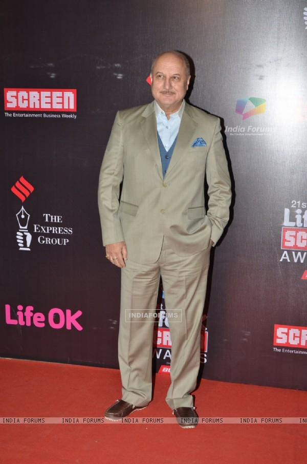 Anupam Kher poses for the media at 21st Annual Life OK Screen Awards Red Carpet