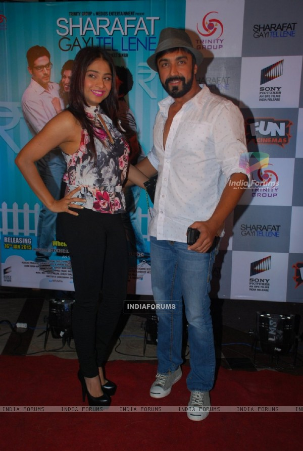Ashish Chowdhry poses with wife Samita Bangragi at the Premier of Sharafat Gayi Tel Lene
