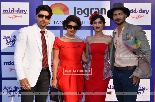 Celebs pose for the media at Mid Day Race