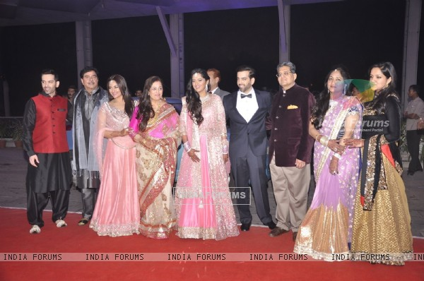 Family members pose for the media at the Wedding Reception of Kush Sinha