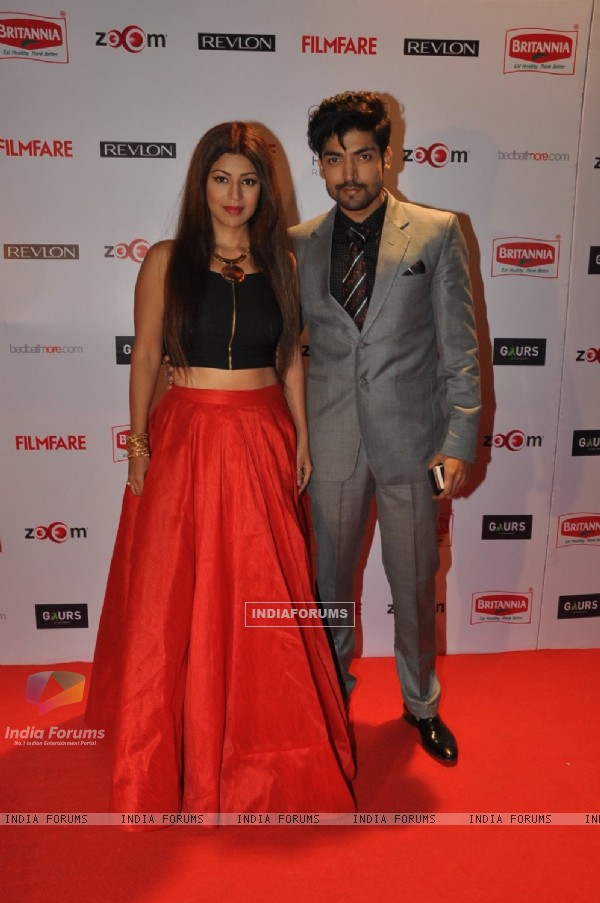Gurmeet Choudhary and Debina Bonnerjee Choudhary pose for the media at Filmfare Nominations Bash