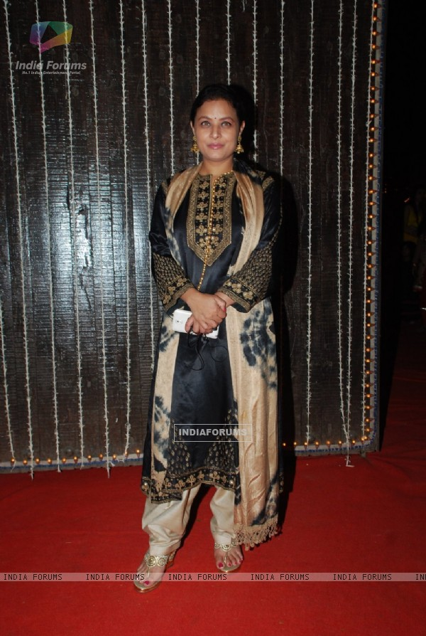 Sharbani Mukherjee poses for the media at Bappi Lahiri's Wedding Anniversary