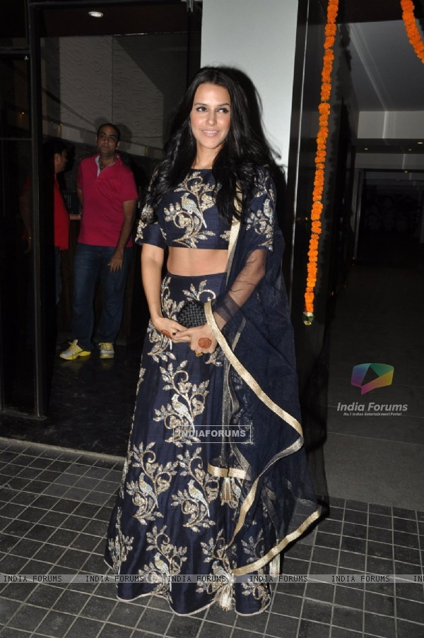 Neha Dhupia poses for the media at Soha Ali Khan and Kunal Khemu's Wedding Reception