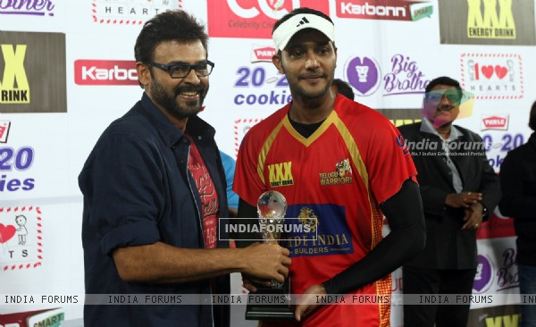 Daggubati Venkatesh gives an award at CCL Match Between Mumbai Heroes and Telugu Warriors