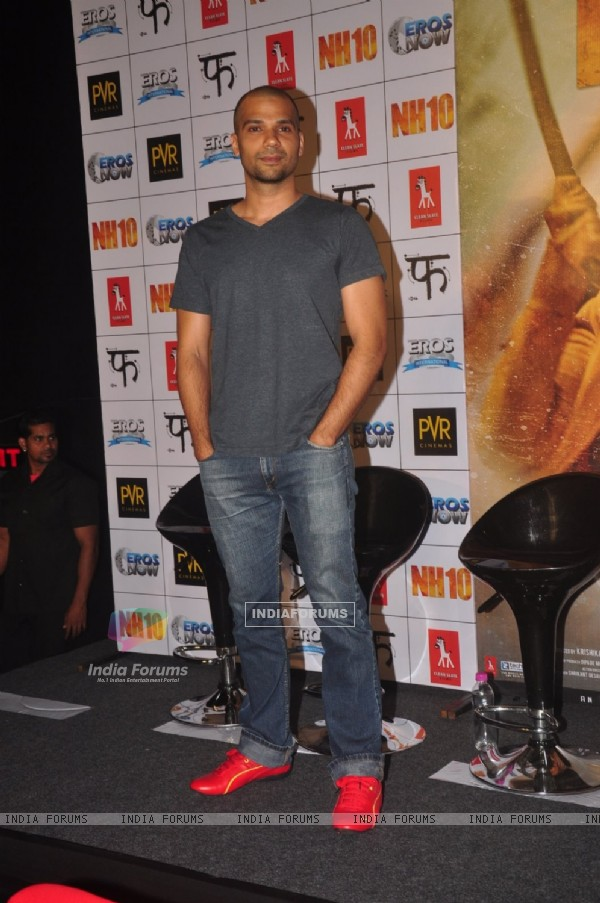 Neil Bhoopalam poses for the media at the Promotions of NH10