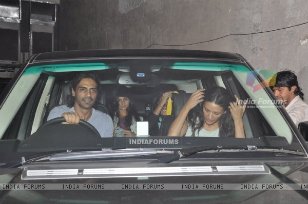 Arjun Rampal was snapped driving his car at the Special Screening of Roy