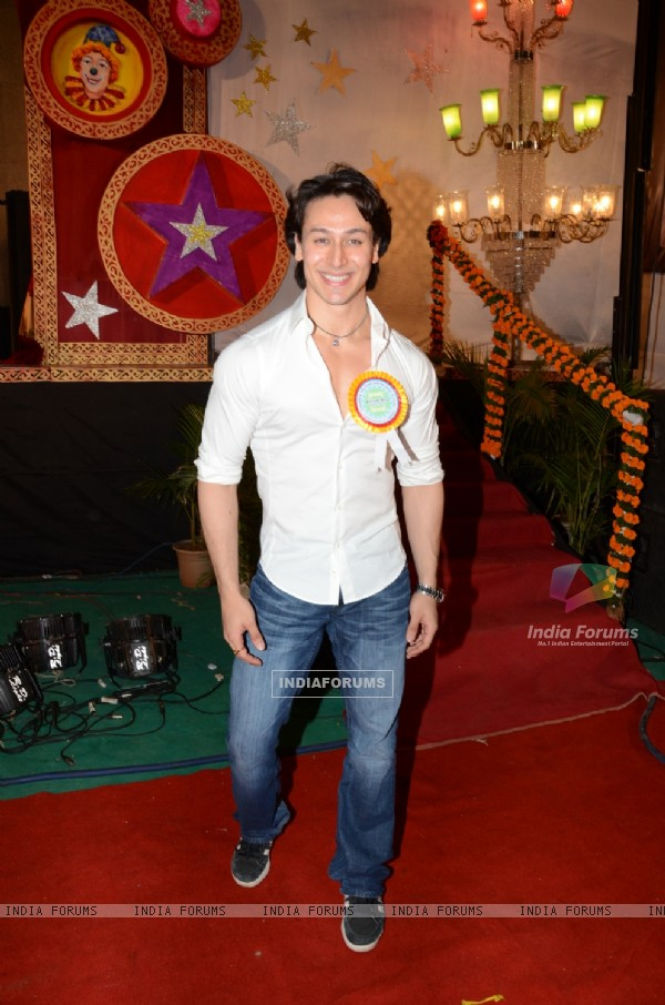 Tiger Shroff poses for the media at the Annual Day of Children's Welfare Centre High School