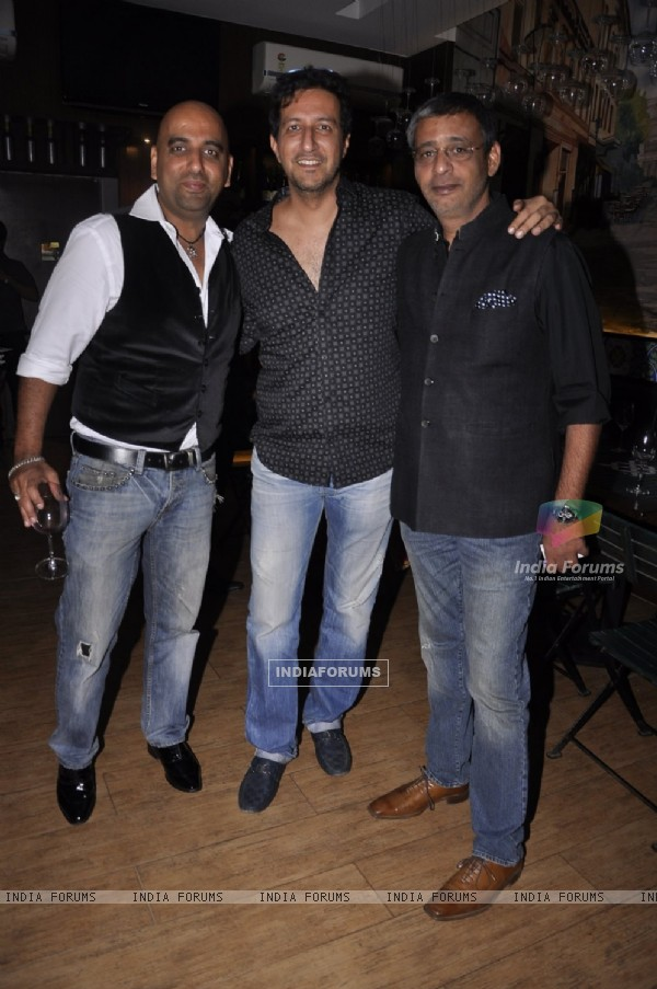 Sulaiman Merchant poses with friends at Cafe D'WINE