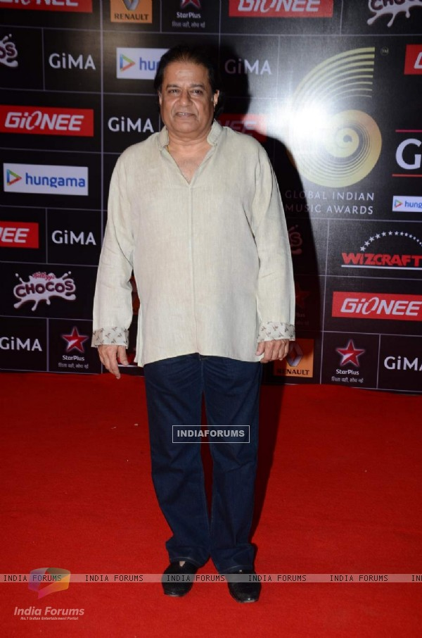 Anup Jalota poses for the media at GIMA Awards 2015