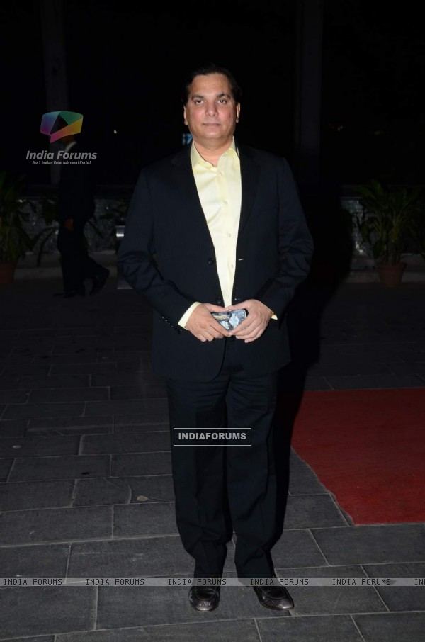 Lalit Pandit poses for the media at Tulsi Kumar's Wedding Reception