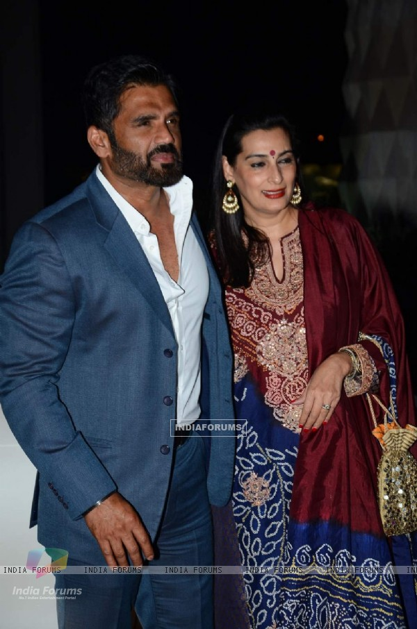 Suniel Shetty and Mana Shetty pose for the media at Tulsi Kumar's Wedding Reception