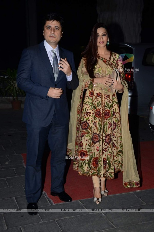 Goldie Behl and Sonali Bendre pose for the media at Tulsi Kumar's Wedding Reception