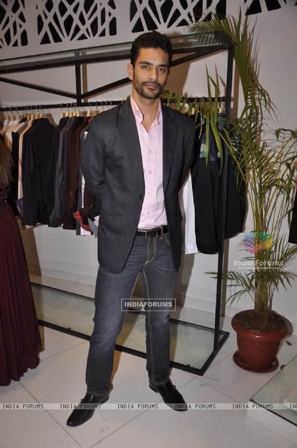 Angad Bedi poses for the media at Narendra Kumar's Store Launch