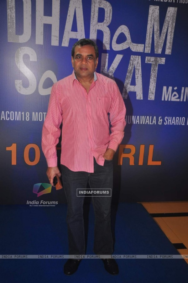 Paresh Rawal poses for the media at the Trailer Launch of Dharam Sankat Mein