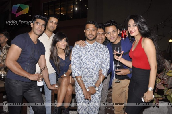 Ken Ferns poses with friends at his 2015 Collection Bash