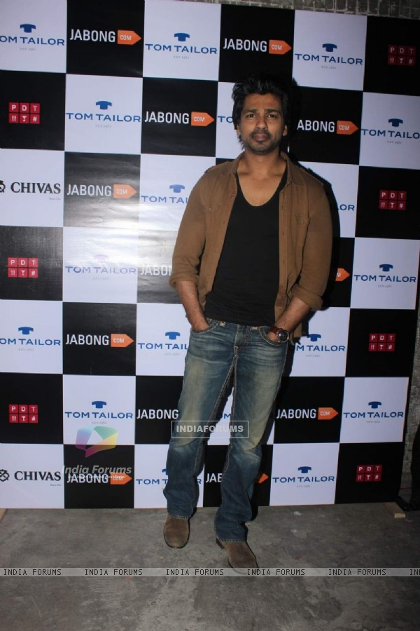 Nikhil Dwivedi poses  for the media at Tom Tailor and Jabong Bash
