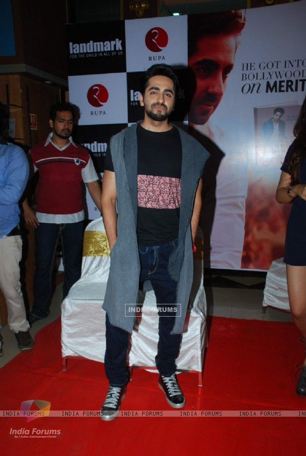 Ayushmann Khurrana poses for the media at the Launch of Book 'Cracking The Code'