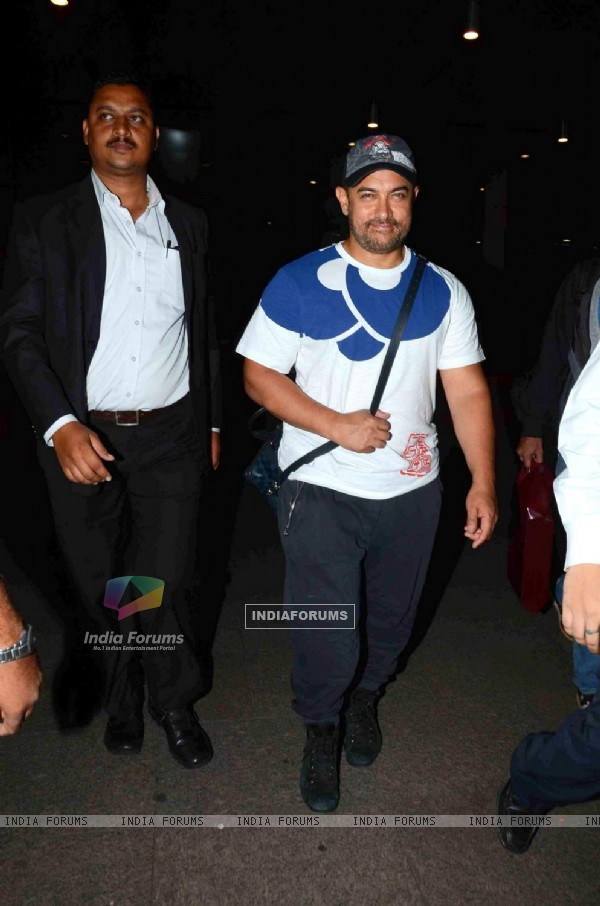 Aamir Khan poses for the media while returning from Disneyland Trip