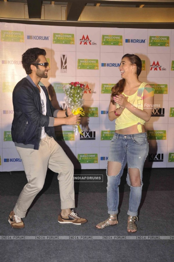 Jackky Bhagnani giving Lauren Gottlieb a bouquet of flowers at the Promotions of Welcome To Karachi