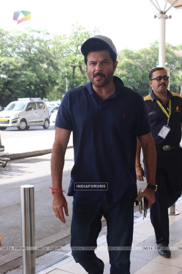 Anil Kapoor poses for the media at Airport