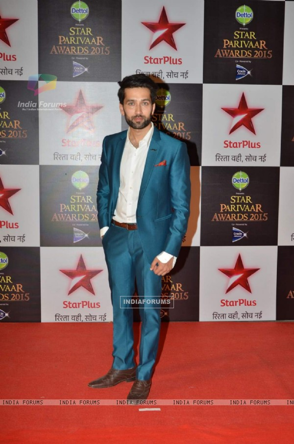 Nakuul Mehta poses for the media at Star Parivaar Awards 2015