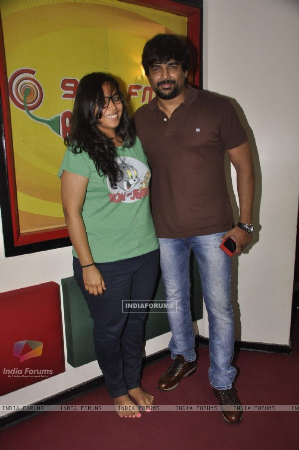 R. Madhavan poses with RJ Prerna at Radio Mirchi Studio