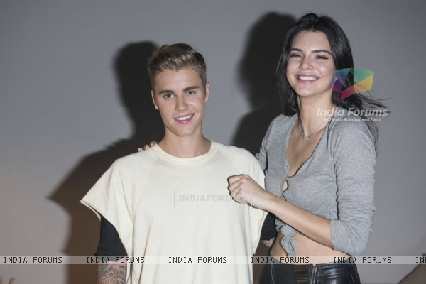 Justin Bieber and Kendall Jenner pose for the media at Calvin Klein Jeans Music Event in Hong Kong