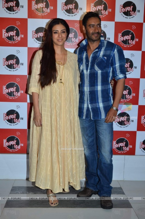Ajay Devgn and Tabu pose for the media at the Promotions of Drishyam on Fever FM