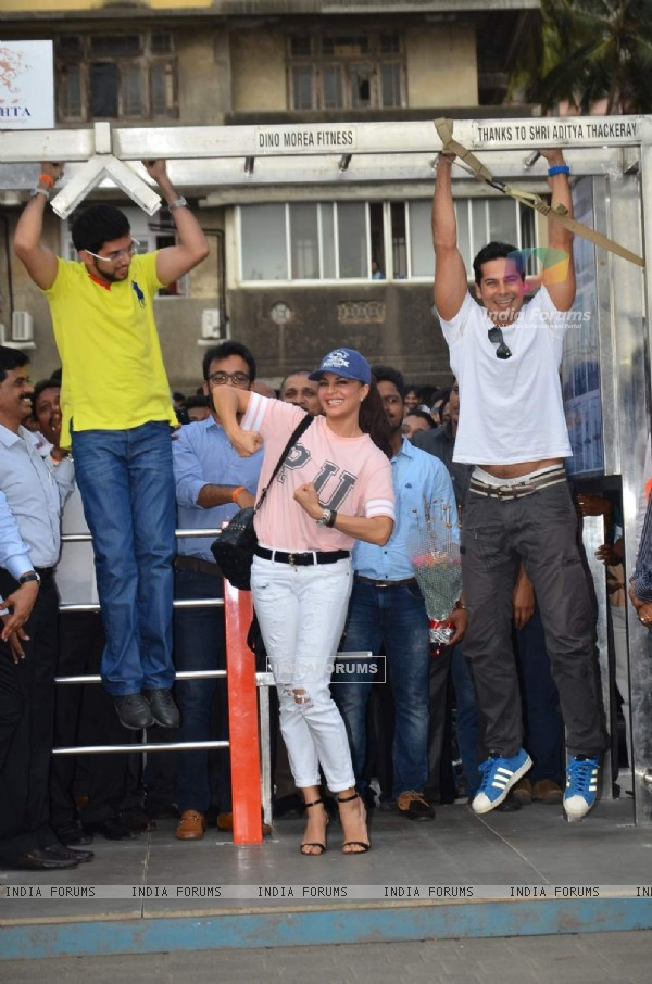 Aditya Thackeray and Dino Morea were snapped doing push ups at the Launch of Free Public Gym