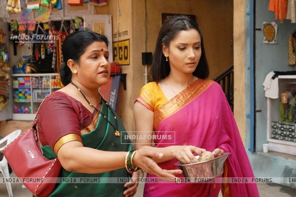 Sulochana and Archana buying vegetable