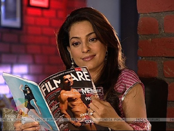 Juhi Chawla reading magazine
