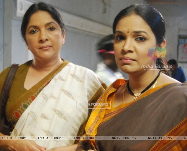 A still image of Shubha and Nanda