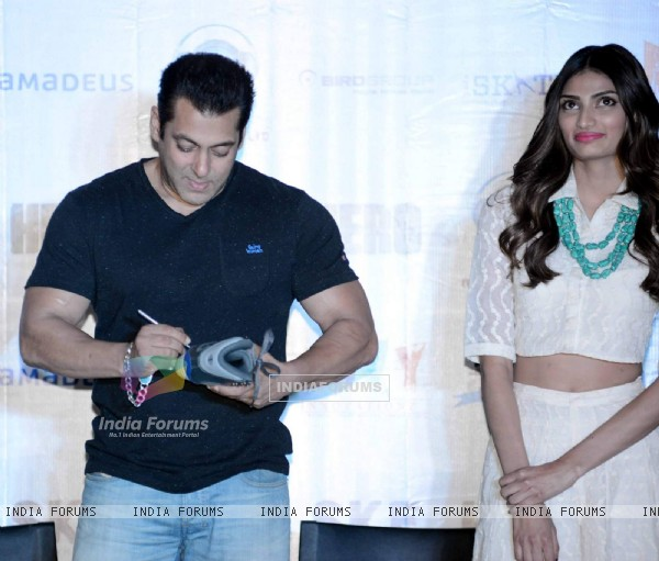 Salman Khan Signs the Shoe During the Press Meet of 'Hero' in Gurgaon