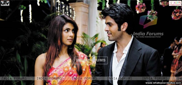 Priyanka Chopra and Harman Bewaja looking each other