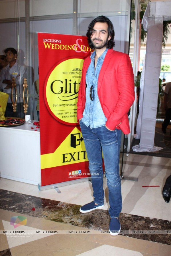 Karan V Grover poses for the media at Glitter 2015 Event