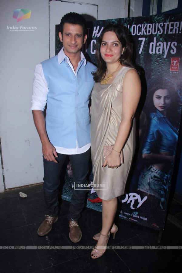 Sharman Joshi along with wife Prerana Chopra poses for the media at the Success Bash of Hate Story 3