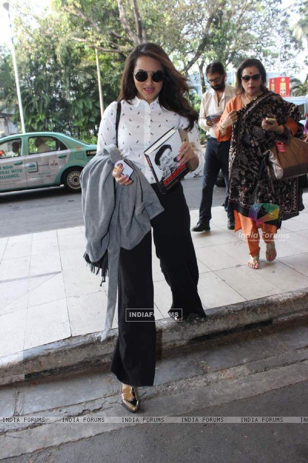 Sonakshi Sinha Snapped With her Father's Book at Airport