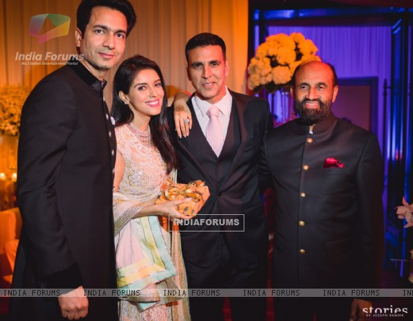 Akshay Kumar Poses with the Newly Married Couple Asin & Rahul Sharma at their Wedding Reception