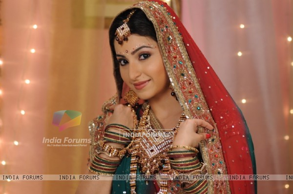 Baby looking beautiful in bridal wear