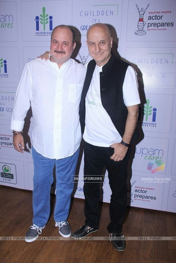 Anupam Kher and Raju Kher at a Charity Event