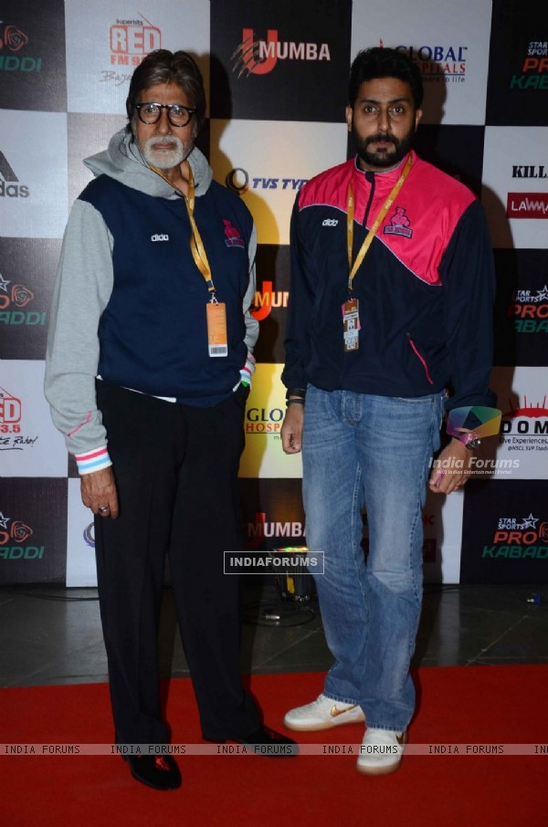 Amitabh Bachchan and Abhishek Bachchan pose for the media at Pro Kabaddi Match