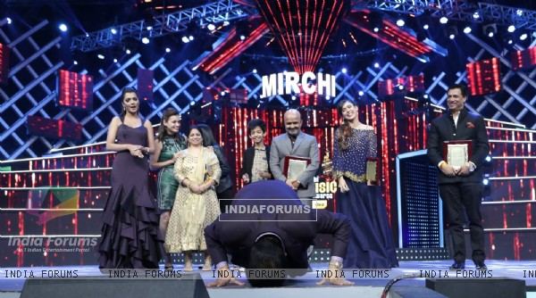 Udit Narayan pays respect to the stage at Mirchi Music Awards 2016