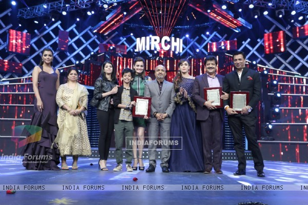 Celebs pose for the media at Mirchi Music Awards 2016