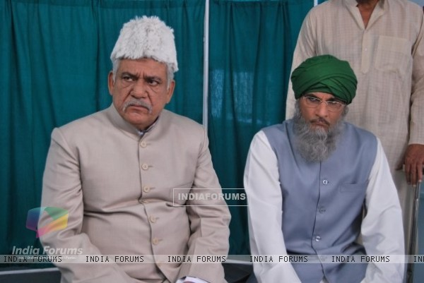 Ompuri and Pavan Malhotra looking angry