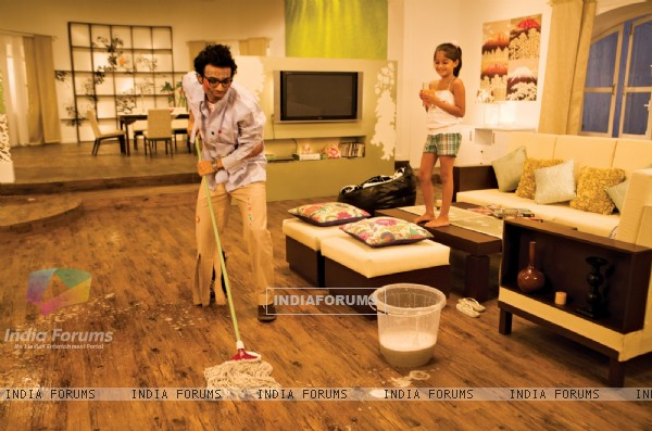 Uday Chopra cleaning the floor