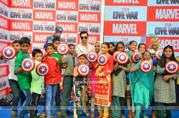 Varun Dhawan Poses with Children at Promotions of Marvel's Captain America